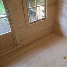 7 x 7 Shire Maulden Log Cabin - interior with detail of floor