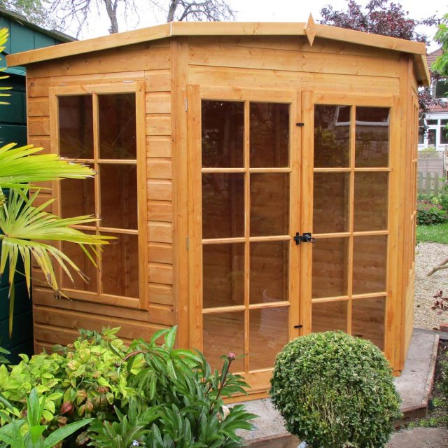 Shire Hampton Corner Summerhouse - Customer image with bushes