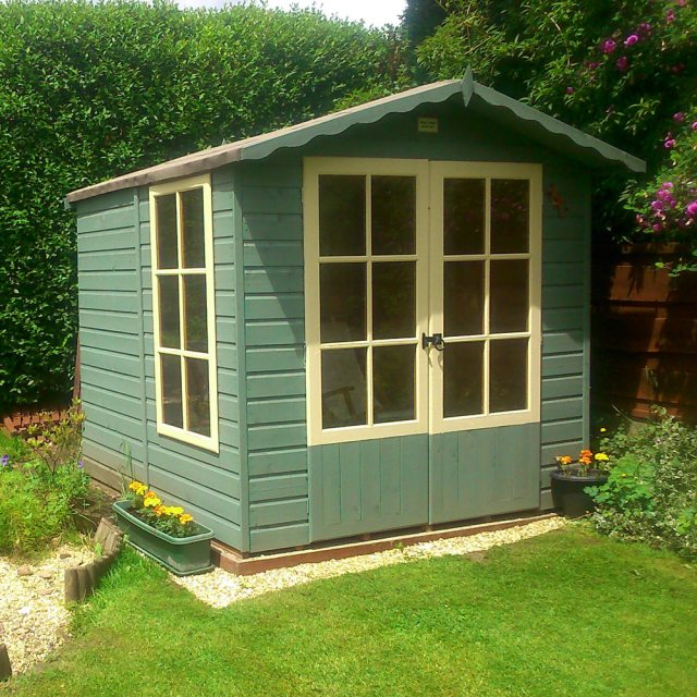 7 x 7 Shire Buckingham Summerhouse - Pressure Treated - insitu with doors closed