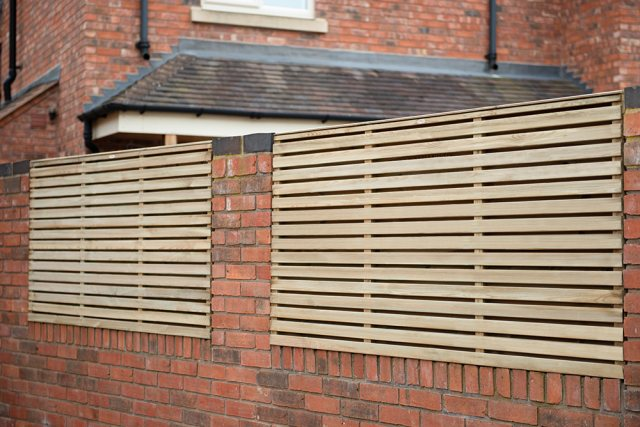 3ft High (900mm) Forest Contemporary Double-Sided Slatted Fence Panel - Pressure Treated - in situ