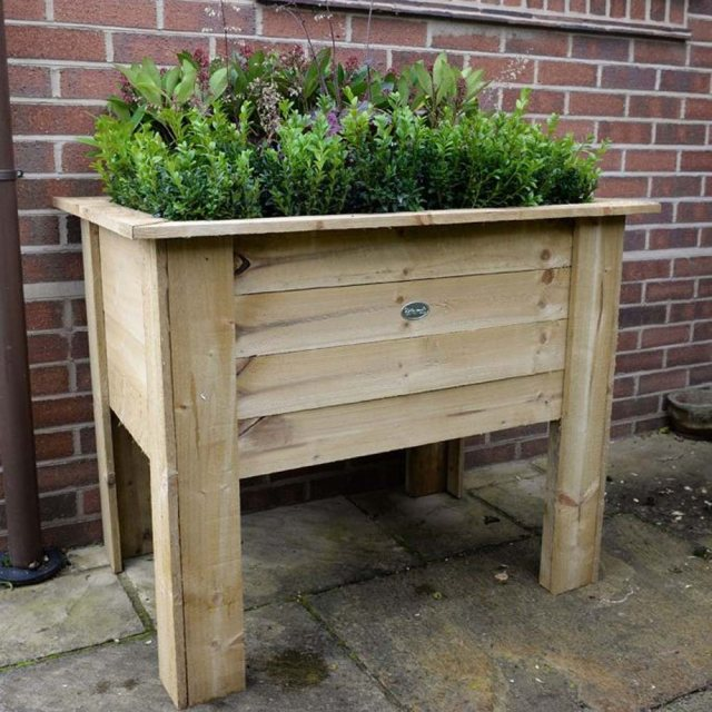 Forest Deep Root Planter - Pressure Treated - 3ft Long - with background and in use