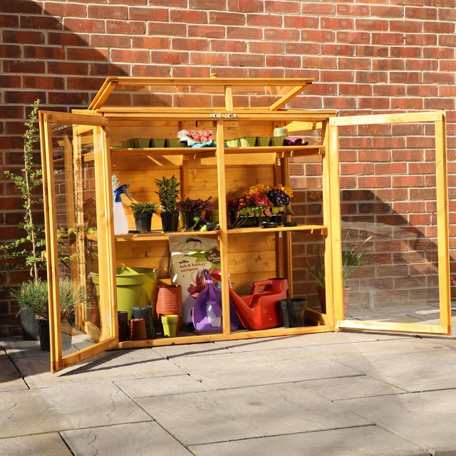 4 x 2 Mercia Mini Greenhouse - in situ, being used for storage
