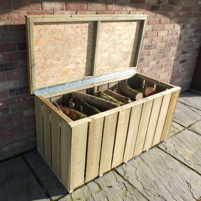 4 x 2 Shire Pressure Treated Log Box with Sawn Timber - insitu, lid open, and filled with logs