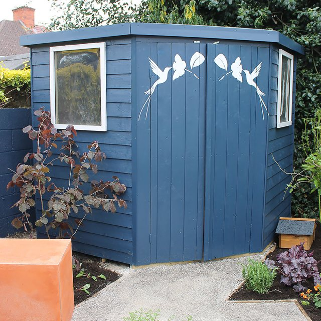 Thorndown Wood Paint - Bishop Blue - Painted on a corner shed