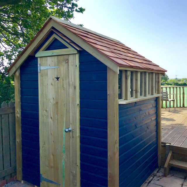 Thorndown Wood Paint - Bishop Blue - Painted on a wooden garden shed